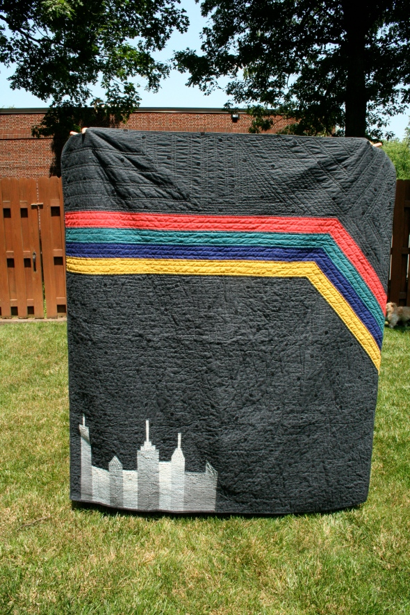Black Quilt with Negative Space, City Skyline and Stripes